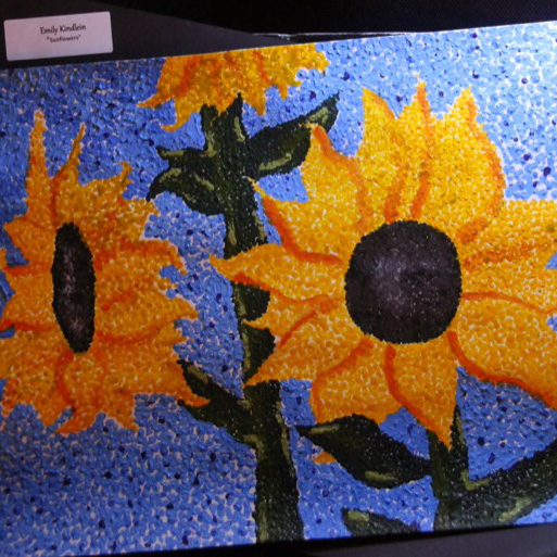 "McNaughton High School hosted an art show featuring the artwork of Grade 10, 11 and 12 students on Thursday, January 18, 2018. ""Sunflowers"" by Emily Kindlein."