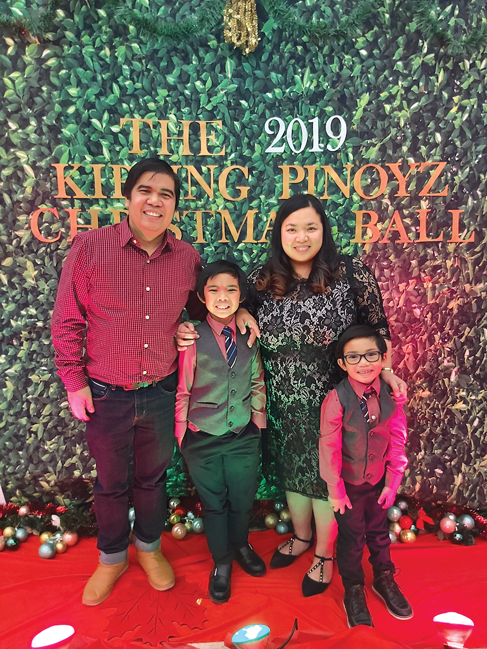 Elainy Cacho with husband Dennis and sons Eiden and Lorenzo.<br />