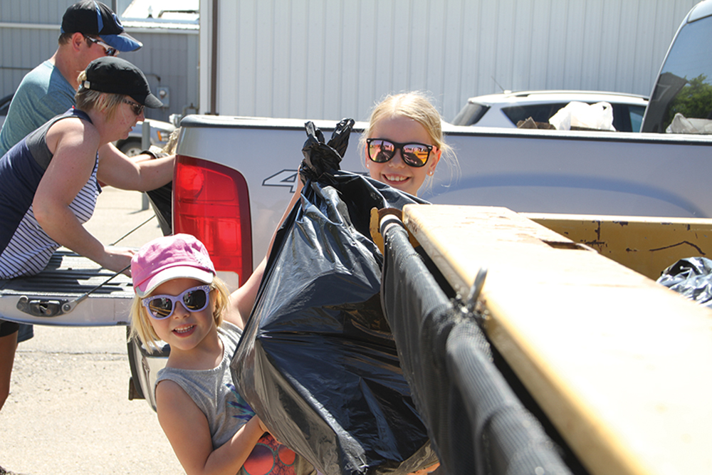 Shown here are some volunteers from a previous community cleanup.