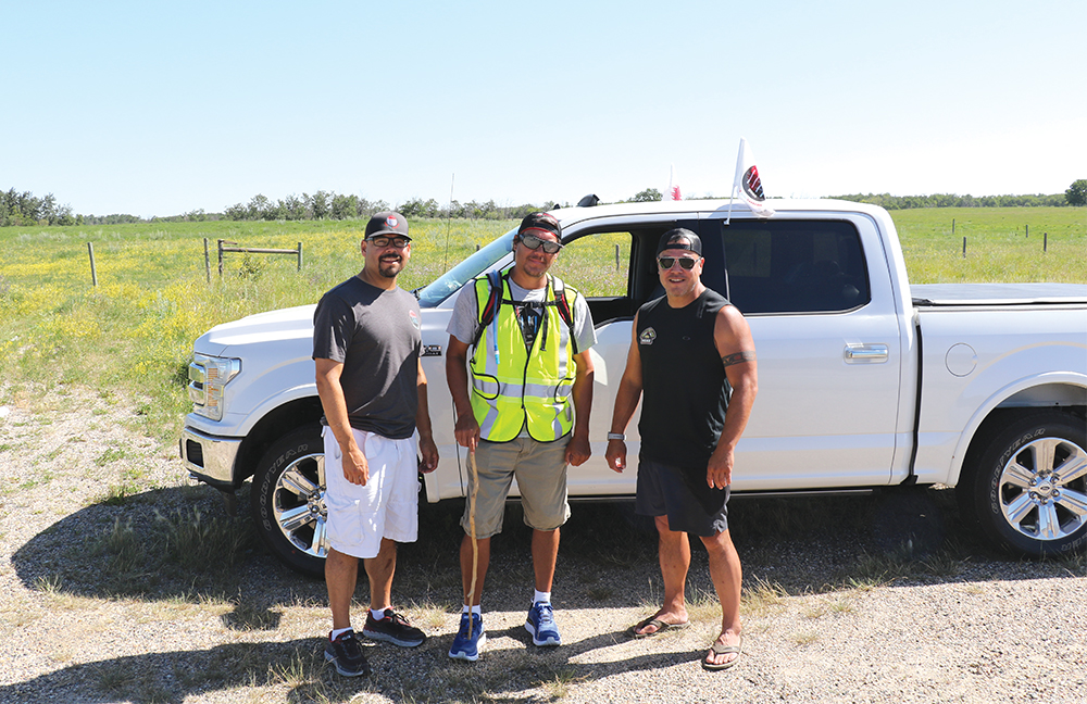 Kevin Redsky (middle) is joined by fellow police officers Mitchell Boulette (left) and Clayton Tait (right) as he makes his journey across Canada.