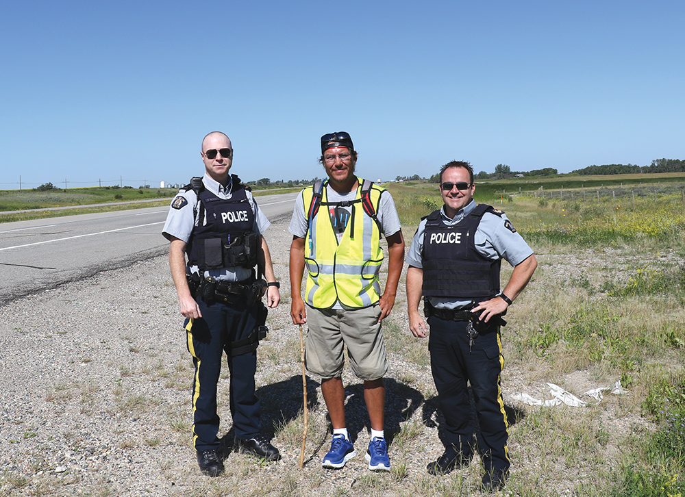 Kevin Redsky with Moosomin RCMP Corporal Damien Grouchy (left) and Sgt. Scott Fefchak (right).