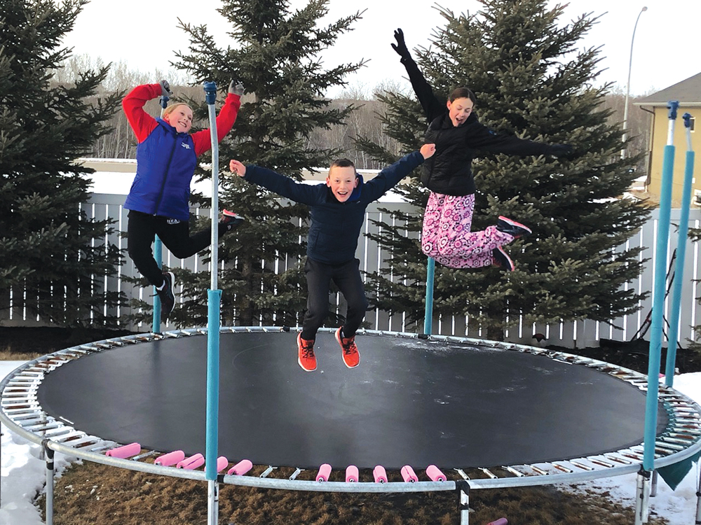 The Unchulenko family from Esterhazy enjoys some outdoor time on the trampoline in their yard while at home during the Covid-19 shutdowns.