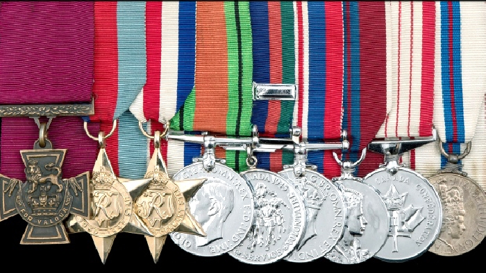 The batch of medals that was sold off in England. The Victoria Cross is at left.
