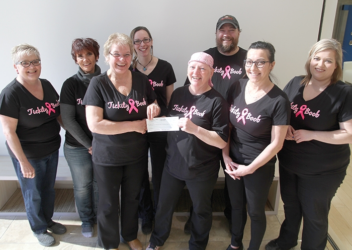 The Tickity Boob Fundraiser on March 24 in Moosomin raised $18,712.74 for Debbie Brown who is undergoing treatments for breast cancer. The proceeds of the fundraiser were presented to Debbie last week by the volunteers who helped organize the fundraiser. In back from left are Lynn Russell, Sharen Hogarth, Anna Hall and Andrew Stacey. In front are Marlyne Primrose presenting a cheque for $18,712.74 to Debbie Brown. At right are Mona Windrim and Kim Dawson.