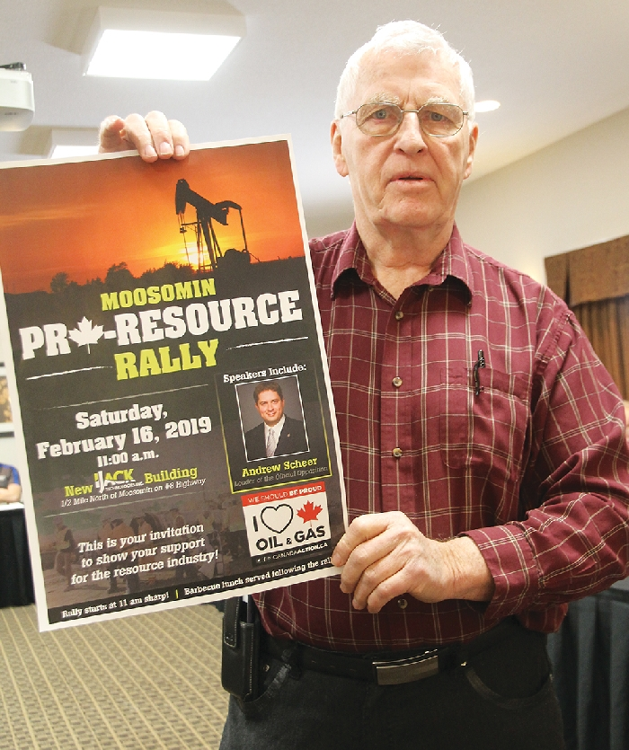 Sinclair Harrison holds up the poster for the planned Moosomin pro-resource rally at the Chamber meeting Wednesday. Harrison and Bill Thorn spoke about the rally being planned for Feb. 16 with Andrew Scheer as guest speaker.