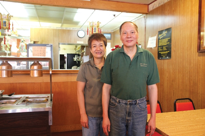 Lisa and Lobo Yiu standing in their restaurant, Yiu's Garden Restaurant, last week. The couple has been in Moosomin 18 years and in the restaurant business in this area for over 30 years.