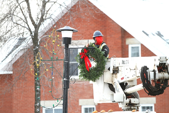 <b>Decking the streets</b>Town of Moosomin employees were busy putting up wreaths of fresh greenery along Main Street last week. The cost of the wreaths is shared between the town of Moosomin and the Chamber of Commerce.