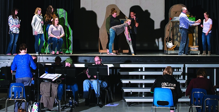 "The actors, above, and the band below, practicing at the Conexus Convention Centre for ""Into the Woods."""