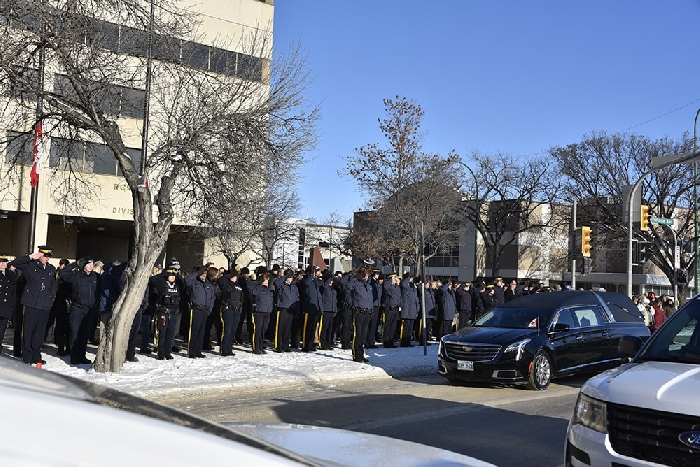 A moment of silence was held for Cst Allan Poapst Tuesday, as the motorcade paused in front of the Manitoba RCMP Headquarters and gave all employees a chance to pay their respects.