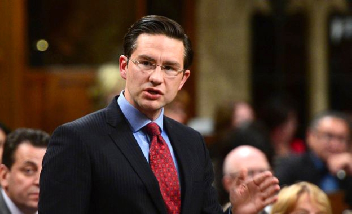 Conservative MP Pierre Poilievre stands during question period in the House of Commons on Oct. 18, 2017.