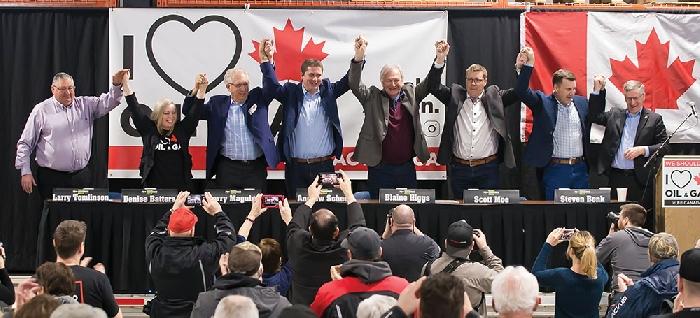 Speakers join hands at the end of the Pro-Resource Rally in Moosomin on Saturday, Feb. 16. From left are Mayor Larry Tomlinson, Senator Denise Batters, Brandon-Souris MP Larry Maguire, Opposition Leader Andrew Scheer, New Brunswick Premier Blaine Higgs, Saskatchewan Premier Scott Moe, and Moosomin MLA Steven Bonk.