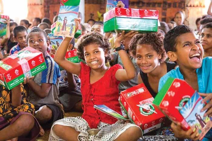 Children receive shoeboxes through Operation Christmas Child.