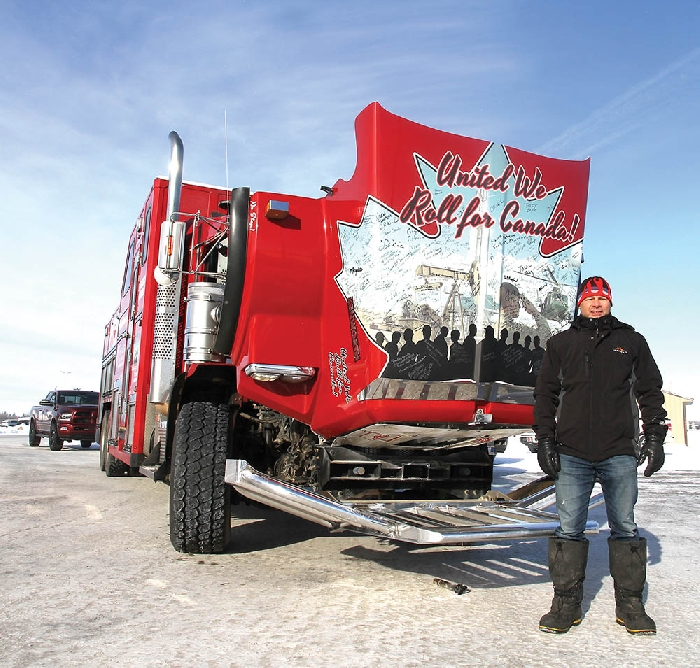 Organizer Glen Carritt of the United We Roll convoy to Ottawa stopped in Moosomin Friday. He was collecting signatures on the hood of his truck along the way. See page 4 for more photos.