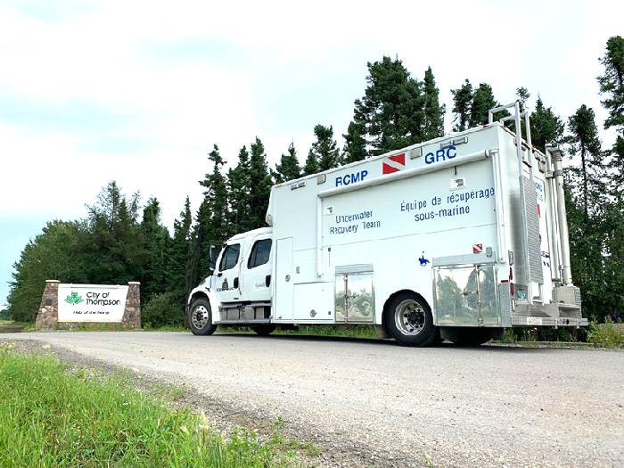 An RCMP underwater recovery team vehicle passes through Thompson, Manitoba on the way to Gillam