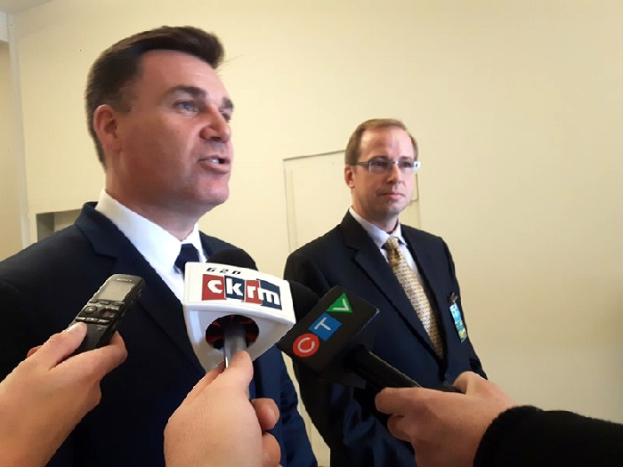 Moosomin MLA and Saskatchewan Minister responsible for Innovation, Steven Bonk, left, and technology innovator Jeff Shirley take questions from reporters