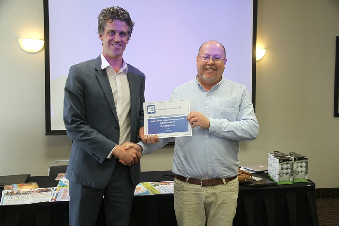 Michael Murray of Block Talk, presents Chamber Secretary Kevin Weedmark with a certificate acknowledging that Moosomin is now on Block Talk.