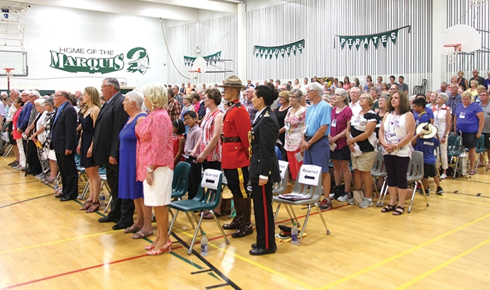 The crowd at the reunion ceremony filled the McNaughton High School gym.