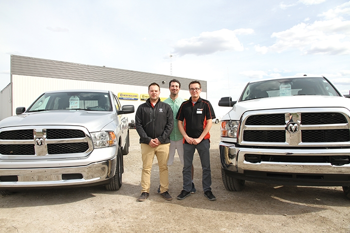 Above: Austin Vargo, Marcel Legault, and Tim Kaban with some of the vehicles they are selling at Whitewood Dodge's off-site sales office in Moosomin. Starting this Wednesday, Whitewood Dodge will have a salesperson operating out of the Mazergroup location in Moosomin. Once Mazergroup completes its new building, a new Chrysler Dodge dealership will be developed.