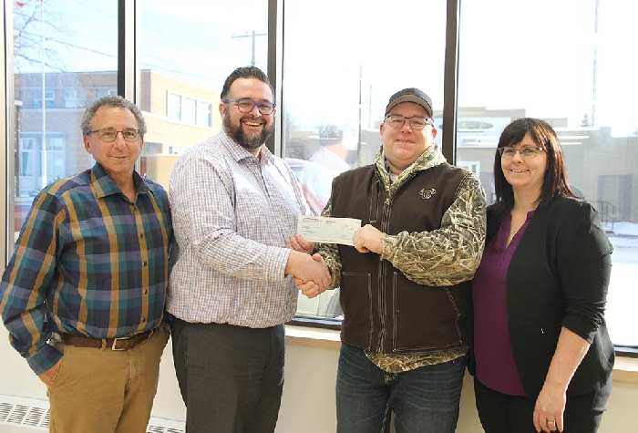 <b>$100,000 from Conexus for airport</b><br> Conexus Credit Union presented a cheque for $100,000 last week for the expansion of Moosomin's airport to accommodate the Saskatchewan Air Ambulance. From left are Jeff St. Onge of the airport planning committee, Conexus Moosomin Branch Manager Brandon Carter, RM of Moosomin Reeve David Moffatt and RM of Moosomin administrator Kendra Lawrence.