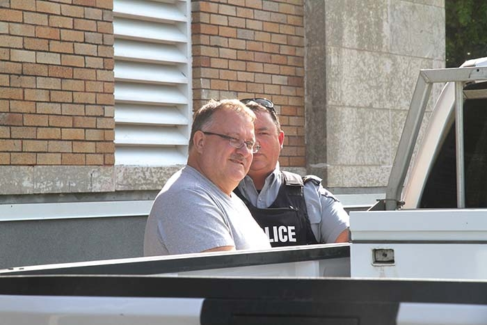 Gregor Gmerek is led out the back door of the Yorkton Court of Queen's Bench courthouse Tuesday afternoon to be taken to prison. Gmerek was given two four-year penitentiary sentences, for fraud and forgery, to be served concurrently. He was led out of the courtroom in handcuffs following the sentencing.