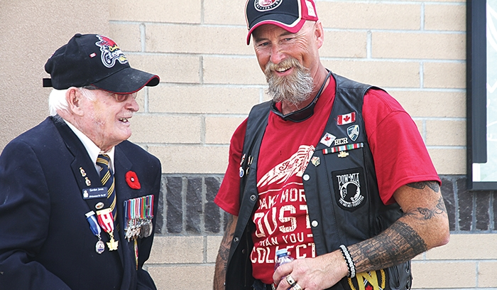 Rolling Barrage organizer Scott Casey speaks with Moosomin veteran Gordon Jones at last year's fundraiser in Moosomin.