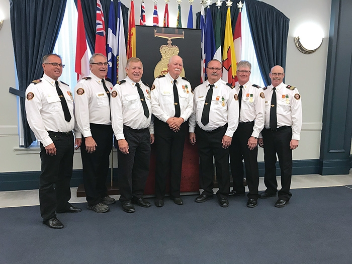 Seven members of the Moosomin Fire Department were presented with the Saskatchewan Protective Services Medal at Government House in Regina last week. From left are Fire Chief Rob Hanson, Jack Thompson, Greg Nosterud, Robert Moran, Joe Matichuk, Richard Hogarth and Deputy Fire Chief Mike Cooper.