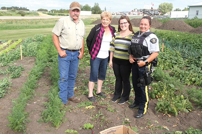 Tim Hovdestad, Marilyn Klinger, Samantha Campbell and Trina Brace at the community garden.