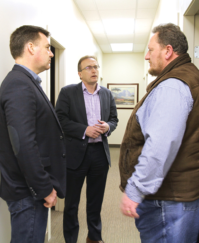 Moosomin MLA Steven Bonk, left, and Health Minister Jim Reiter, centre, discuss health issues with Dr. Wessell Roets at the Moosomin Family Practice Centre Monday.