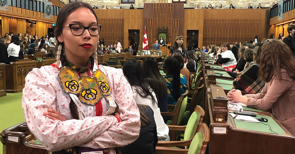 """Kailey-Arthurson, the Daughters of the Vote representative for Churchill-Keewatinook Aski which covers all of Northern Manitoba, turns her back on Prime Minister Justin Trudeau in the House of Commons Wednesday. <br><br><br /> Arthurson said the protest was her way of supporting Jody Wilson-Raybould. She said she wanted Trudeau to """"realize when he shoots down one Indigenous woman, he can't shoot us all down. We all wanted to make a statement together."""