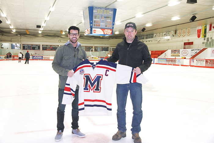 Todd Davidson and Paul Stapleton with the Rangers' 40th anniversary retro jersey. Davidson, the owner of Davidson Truck and Tractor, is a Rangers alumni and a long-time sponsor of the team. Davidson helped sponsor the new retro jerseys. Stapleton is the Ranger team captain and has played with the Rangers for 17 years.