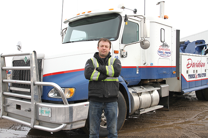 Todd Davidson, the owner of Davidson Truck and Tractor, with his tow truck.