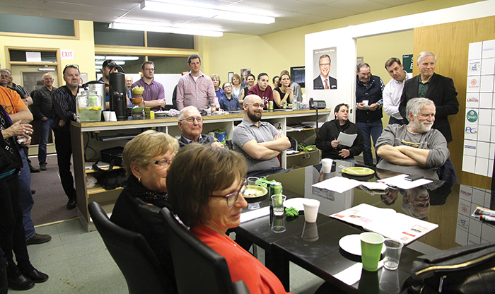 The crowd at Steven Bonk's campaign offices watch as Premier Brad Wall makes his victory speech on election night. Former Moosomin MLA Don Toth and newly elected MLA Steven Bonk are standing at right.