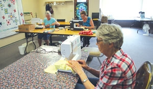 Group sewing for moms and babies from northern communities